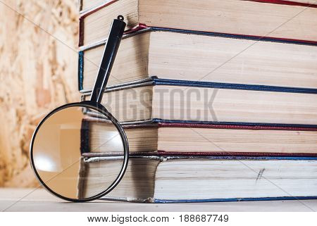 Magnifying Glass And Books,
