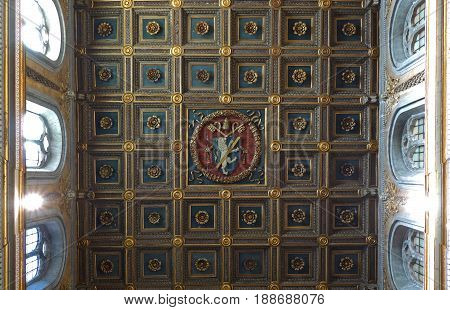 ROME ITALY - MAY 27 2017: Interior of the San Marco minor basilica detail of the wooden coffered ceiling with Papal coat of arms