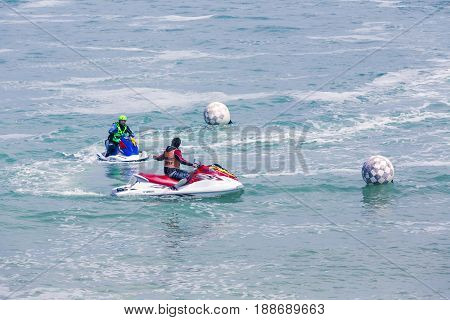 Veulette sur mer Normandy France - May 28 2017. Unidentified competitors are riding jet ski boat for a race championship France. Jet in motion