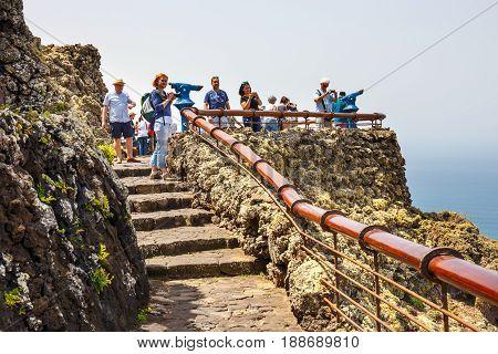 Mirador del Rio Lanzarote March 31 2017: People enjoing Impressive view from Mirador del Rio to island of La Graciosa Lanzarote Canary islands