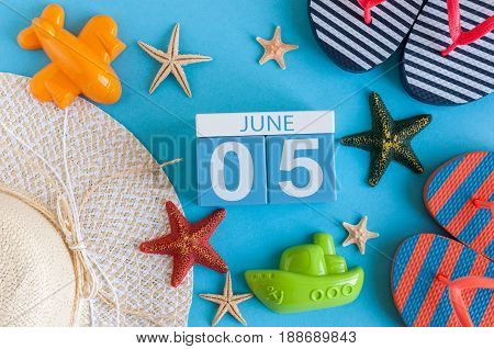 June 5th. Image of june 5 calendar on blue background with summer beach, traveler outfit and accessories. Summer day.