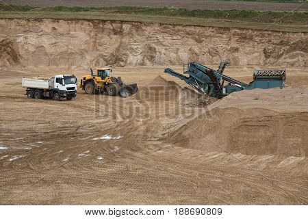 Truck, Loader And A Gravel Separator On Outcrop Site