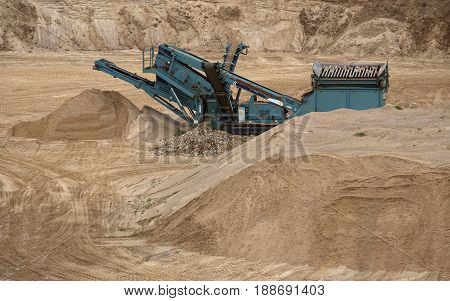 Gravel Separator Between Sand Heaps On Outcrop Site