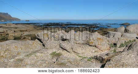 HUGE BOULDERS IN FORE GROUND, WITH BLUE HORIZON IN THE BACK GROUND 22avse