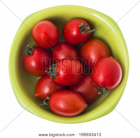 Small ripe red tomatoes in green bowl. Studio Photo