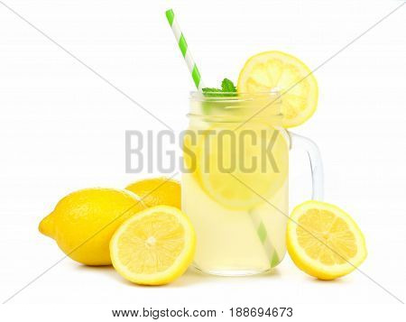 Mason Jar Glass Of Lemonade With Lemons And Straw Isolated On A White Background