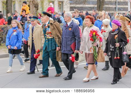 Kirishi, Russia - 9 May, Veterans of war in the column, 9 May, 2017. Preparation and conduct of the action Immortal regiment in small cities of Russia.
