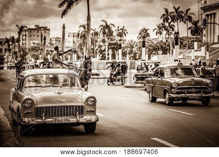 Havana, Cuba - September 14, 2016: HDR - American classic cars on the main street before the capitolio in Havana Cuba - Retro Serie SEPIA Cuba Reportage