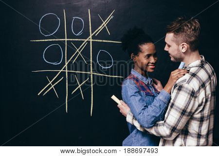 Couple Young Fun Leisure Game Play Tic Tac Toe Happy Together Relationship Hug Support Victory Vinner Concept