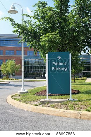 Patient Parking Sign. A sign pointing to the patient parking lot on a metropolitan hospital campus