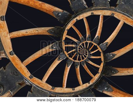 Abstract spiral wooden wagon cannon wheel with black metal brackets, rivets. Wheel wooden spokes fractal background. Horse vehicle wheel pattern two strands spiral fractal background Isolated on black