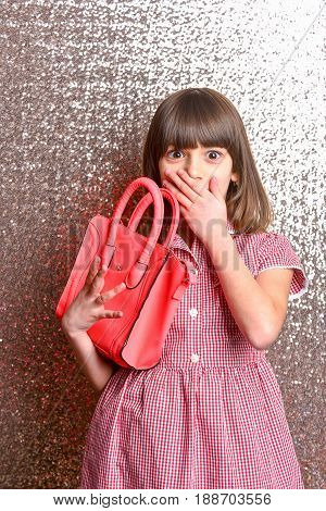 Small Pretty Surprised Girl With Fashionable Red Leather Bag