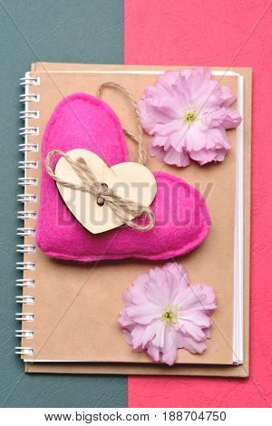 Notebook And Pink Heart With Wooden Decor And Pink Flowers