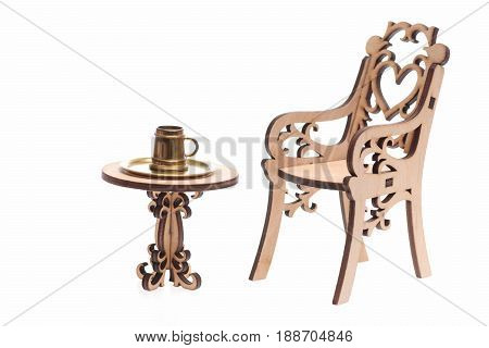 antique pint of beer or mug on golden tray on vintage table with engraved chair isolated on white background copy space