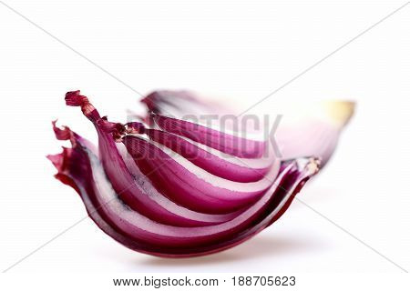 Slices Of Red Onion Quarter Painted In Purple Colour