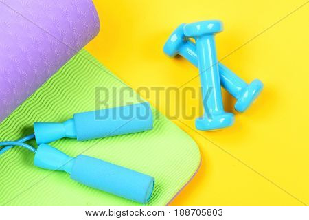 Idea Of Healthy Lifestyle With Blue Dumbbells And Skipping Rope