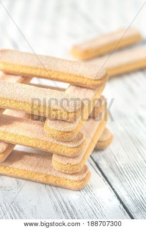 Ladyfinger biscuits (savoiardi) on the wooden background