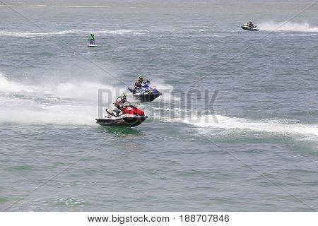 Veulette sur mer, Normandy, France - May 28, 2017. Unidentified competitors are riding jet ski boat for a race, championship France. Jet in motion