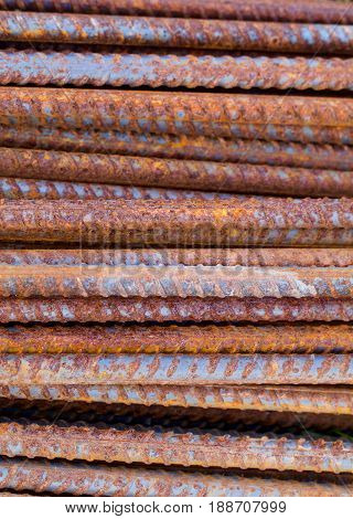 A vertical format closeup shows rusty reinforcing rods.