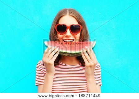Portrait Happy Woman Is Eating Slice Of Watermelon Over Colorful Blue Background