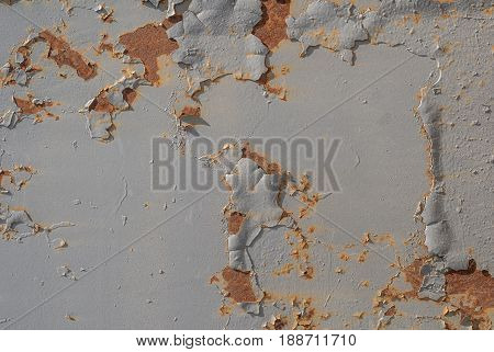 surface of rusty iron with remnants of old paint, chipped paint, texture background