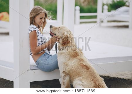 girl playing with a dog at the beach and in the park