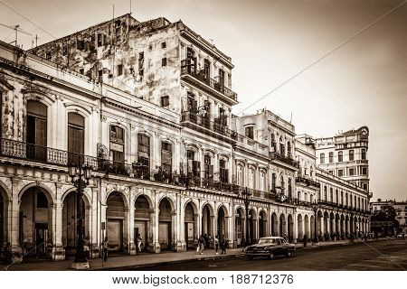HAVANA, CUBA - JULY 05, 2015: HDR - Architecture with street life view in Havana City Cuba - Retro Serie SEPIA Cuba Reportage