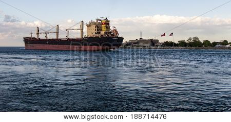 Port Huron, Michigan, USA - May 29, 2017: Great Lakes freighter Strandja upbound on the international waterway of the St. Clair River on the US and Canadian border.