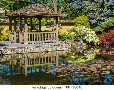Japanese garden design with water stream and gazebo