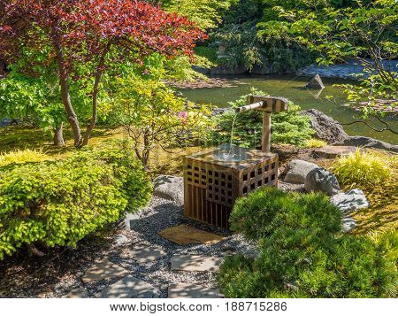 Japanese garden design with water stream and traditional ornaments