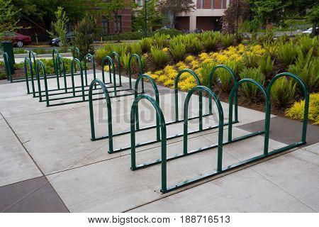 Empty bike racks on a sidewalk at a university in Oregon.