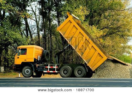 Dump-body truck in work
