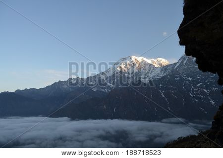 Mountain Landscape in Himalaya. Above clouds. Annapurna South peak, Nepal, Mardi Himal track.