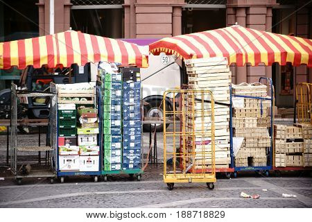 MAINZ, GERMANY - APRIL 20: Sales stand of the weekly market at the market square in Mainz pack their goods together on April 20 2017 in Mainz.
