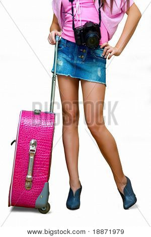The girl with a suitcase in a pink jacket. It is isolated on a white background