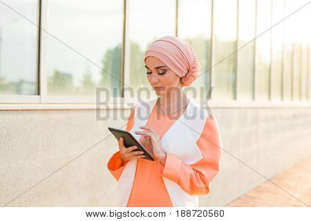 pretty modern Arabian woman with tablet computer