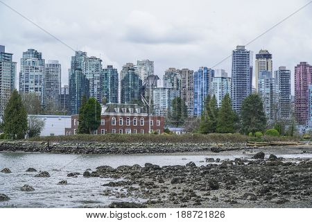 The skyline of Vancouver harbourfront - dramatic sky -  CANADA