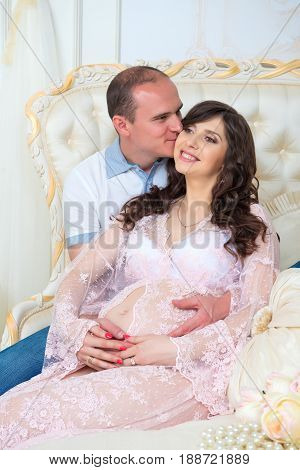 Happy Couple: husband and pregnant wife waiting for baby.