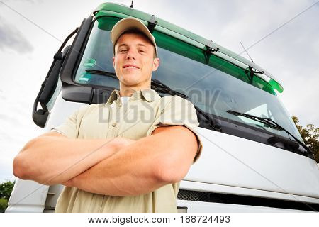 a delivery person is standing next to his white truck.