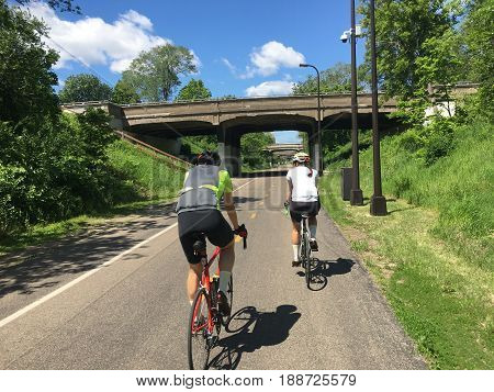 Cyclists on an urban bike path on a beautiful day.