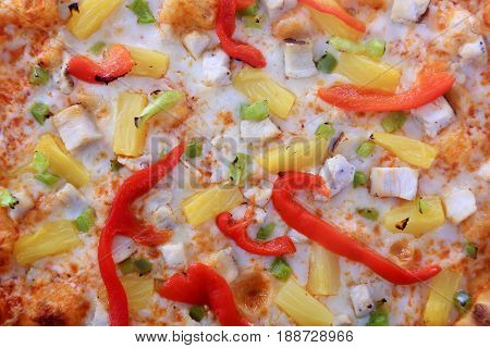 Close up view of a Hawaiian Pizza. Hawaiian Pizza isolated on a white background