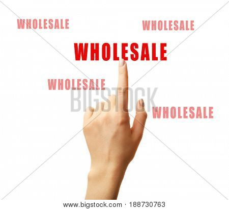 Wholesale concept. Female hand pointing on text against white background