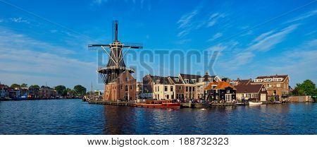 Panorama of Harlem cityscape - landmark  windmill De Adriaan on Spaarne river. Harlem,  Netherlands