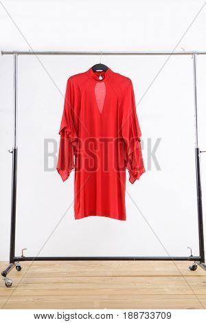 female red sundress hanger isolated –wooden background