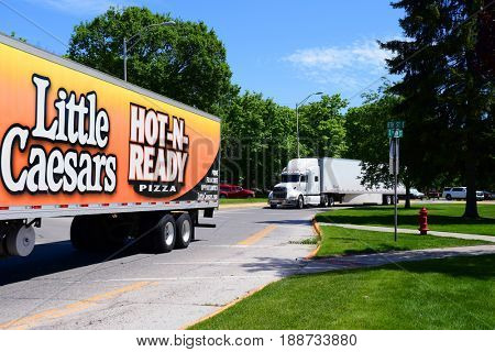 KALISPELL, MONTANA, USA - May 23, 2017: A Little Caesars Pizza semi-truck convoys with another semi through the streets of Kalispell
