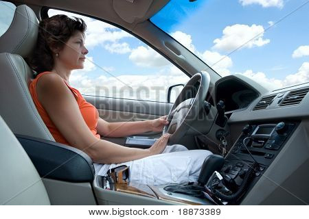 The woman at the wheel the car