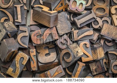 numbers abstract - background of random letterpress wood type printing blocks, top view
