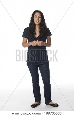 Smiling mixed race woman with hands clasped