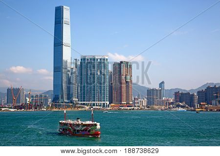 HONG KONG - APRIL 2: Ferry cruising Victoria harbor on April 2, 2017 in Hong Kong, China. Hong Kong ferry is in operation for more than 120 years and is one of main attractions of the city.