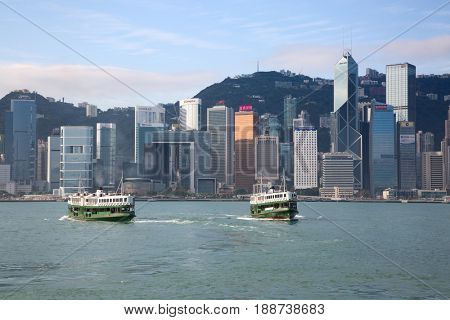 HONG KONG - APRIL 2: Ferries cruising Victoria harbor on April 2, 2017 in Hong Kong, China. Hong Kong ferry is in operation for more than 120 years and is one of main attractions of the city.